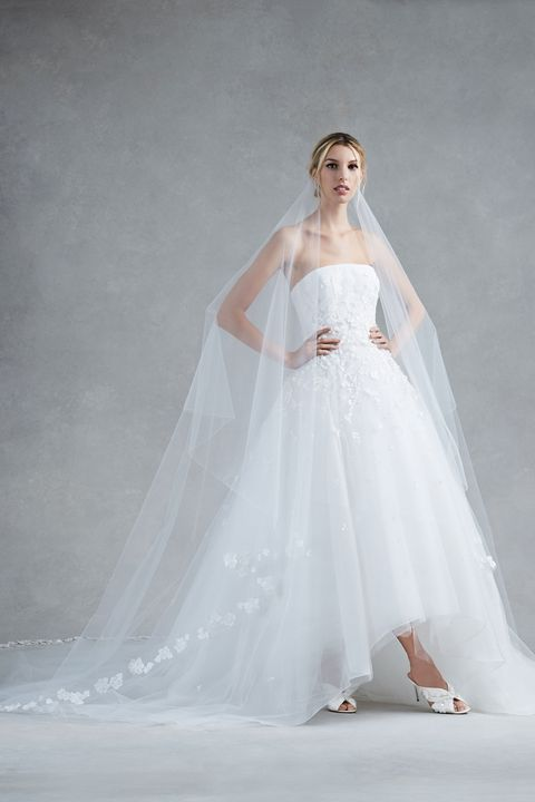 Clothing, Bridal clothing, Sleeve, Skin, Shoulder, Dress, Textile, Gown, Photograph, Joint,