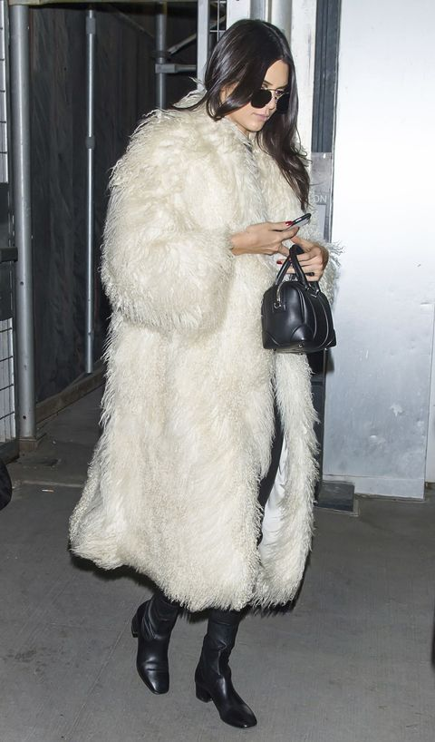 "<p>As the weather turns colder, there's no better way to heat up than in an oversize faux-fur jacket. Follow Kendall Jenner's lead and pair it with sleek over-the-knee black leather boots and add simple diamond sparklers.<span class=""redactor-invisible-space"" data-verified=""redactor"" data-redactor-tag=""span"" data-redactor-class=""redactor-invisible-space""></span></p>"