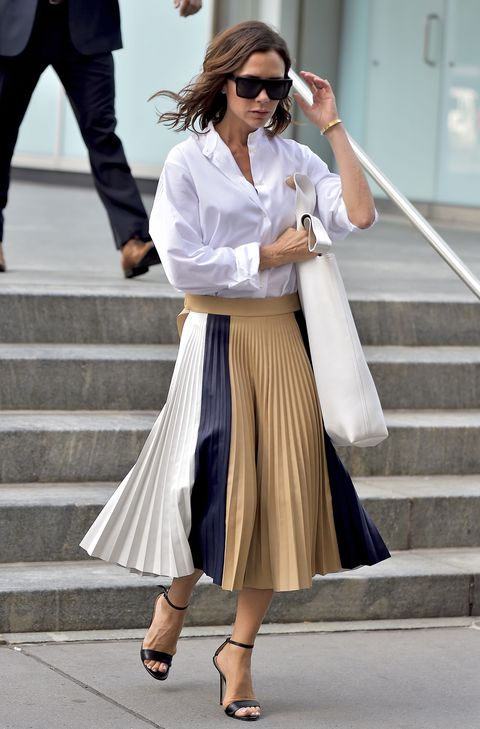 <p> Beckham loves herself a midi skirt, whether worn with a shirt as pictured here, or a silky camisole. While it's easy to write the midi-length off as a little dowdy, they're actually an easy fast-track to autumn/winter 2016 chic. </p>
