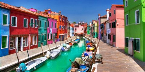 <p>The island of Burano is located in the Venetian Lagoon and is known for its brightly colored houses, which is a tradition that was started by fishermen who painted their houses so they could see them when they were out fishing.</p>