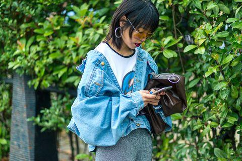 Bag, Camera, Street fashion, Luggage and bags, Gadget, Dreadlocks, Fruit, Digital camera, Cameras & optics, Handbag,