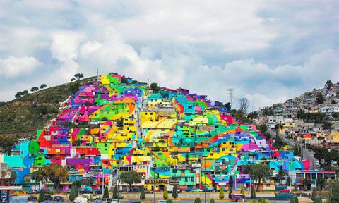 "<p>This district in&nbsp;Mexico commissioned the street art group German Crew to paint the town a <a href=""http://www.housebeautiful.com/lifestyle/a4059/colorful-neighborhood/"" target=""_blank"">rainbow of colors</a>, resulting in what looks like a large and mesmerizing mural.</p>"