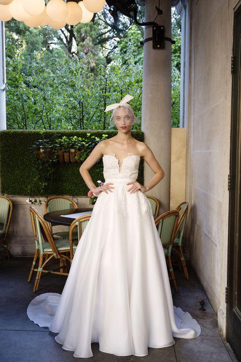 Clothing, Dress, Shoulder, Bridal clothing, Textile, Gown, Strapless dress, Formal wear, Wedding dress, Waist,