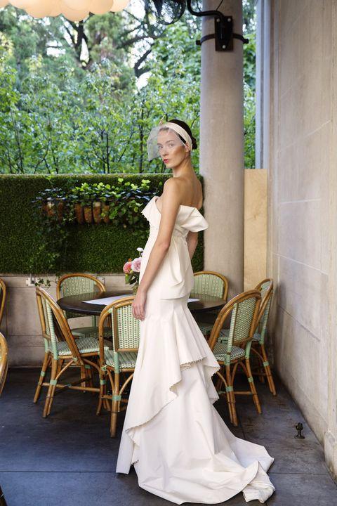 Clothing, Lighting, Human body, Dress, Shoulder, Furniture, Bridal clothing, Gown, Wedding dress, Chair,