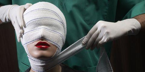 Gesture, Costume accessory, Mannequin, Woolen, Safety glove, Mail,