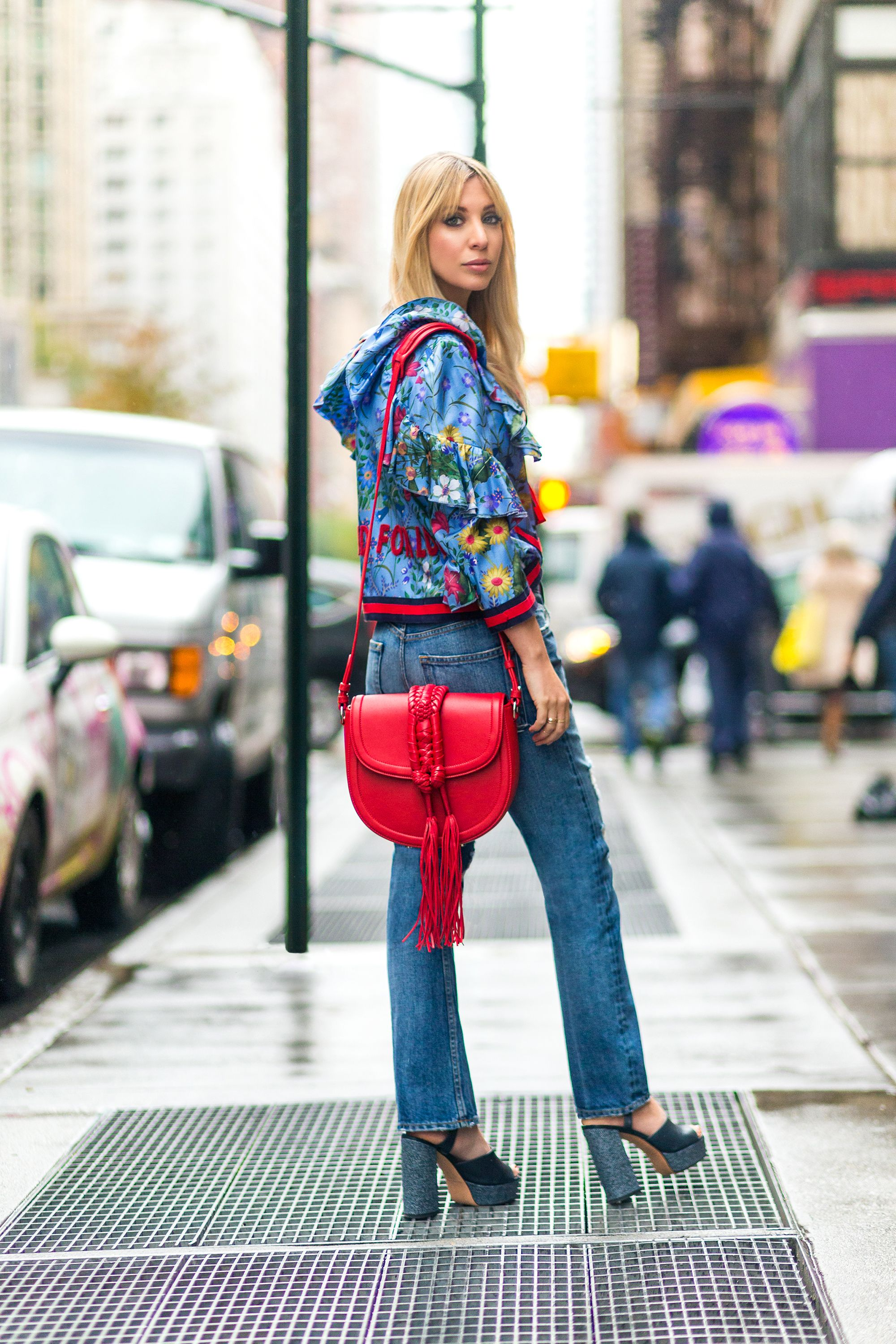 "<p>""Red is definitely the color for now—it pairs perfectly with blue denim—especially on a bag that's as structured and beautiful as this one. I consider a Gucci floral top icing on the stylish cake.""<br><br><em data-redactor-tag=""em"" data-verified=""redactor""><strong data-redactor-tag=""strong"" data-verified=""redactor"">Kerry wears: </strong>Gucci jacket, $4,100, <a href=""https://shop.harpersbazaar.com/designers/gucci/gucci-boxy-jacket-10752.html"" target=""_blank"" data-tracking-id=""recirc-text-link""><strong data-redactor-tag=""strong"" data-verified=""redactor"">shopBAZAAR.com</strong></a>; Brock Collection jeans, $495, <strong data-redactor-tag=""strong"" data-verified=""redactor""><a href=""https://shop.harpersbazaar.com/b/brock-collection/wright-denim-jean-10477.html"" target=""_blank"" data-tracking-id=""recirc-text-link"">shopBAZAAR.com</a></strong>; Derek Lam sandals, $850, <strong data-redactor-tag=""strong"" data-verified=""redactor""><a href=""https://shop.harpersbazaar.com/designers/derek-lam/birgitta-platform-sandal-denim-10754.html"" target=""_blank"" data-tracking-id=""recirc-text-link"">shopBAZAAR.com</a></strong>; Altuzarra <em data-redactor-tag=""em""><em data-redactor-tag=""em"">bag</em></em><span class=""redactor-invisible-space""></span>, $2,195, <strong data-redactor-tag=""strong"" data-verified=""redactor""><a href=""https://shop.harpersbazaar.com/a/altuzarra/ghianda-saddle-knot-bag-red-10484.html"" target=""_blank"" data-tracking-id=""recirc-text-link"">shopBAZAAR.com</a></strong>. </em><span class=""redactor-invisible-space"" data-verified=""redactor"" data-redactor-tag=""span"" data-redactor-class=""redactor-invisible-space""><em data-redactor-tag=""em"" data-verified=""redactor""></em></span></p>"