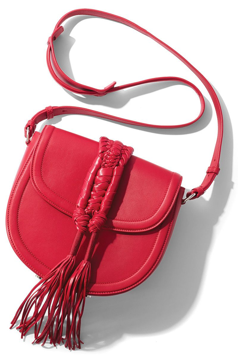 "<p>""This Altuzarra bag, in eye-catching red, has a gorgeous artisanal knot detail inspired by handmade bull ropes, and is the perfect-size cross-body for all occasions,"" says Fritton. ""Whether worn with denim by day, or a little black dress at night, it gives any outfit personality with a pop of color.""<br><br>The other editors' verdict? See below…<br><br><em data-verified=""redactor"" data-redactor-tag=""em"">Altuzarra handbag, $2,195, <strong data-redactor-tag=""strong"" data-verified=""redactor""><a href=""https://shop.harpersbazaar.com/a/altuzarra/ghianda-saddle-knot-bag-red-10484.html"" target=""_blank"" data-tracking-id=""recirc-text-link"">shopBAZAAR.com</a></strong>. </em><br></p>"