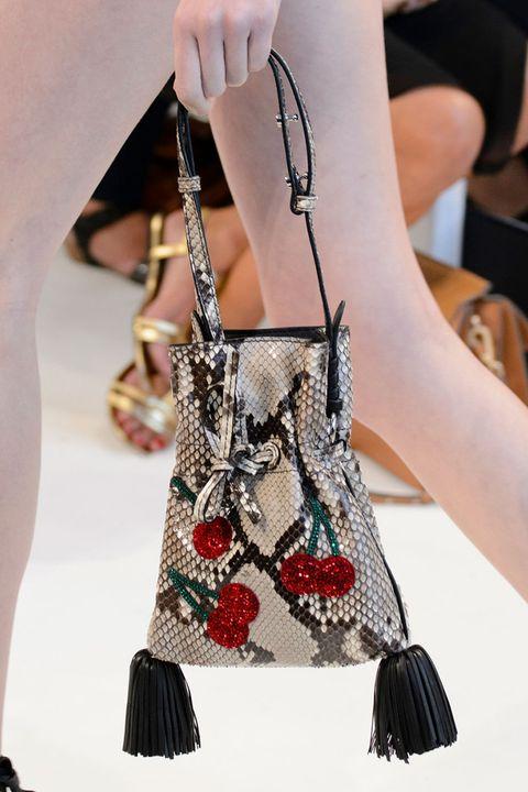 Joint, Style, Bag, Fashion accessory, Fashion, Shoulder bag, Black, Nail, Wrist, Fashion design,