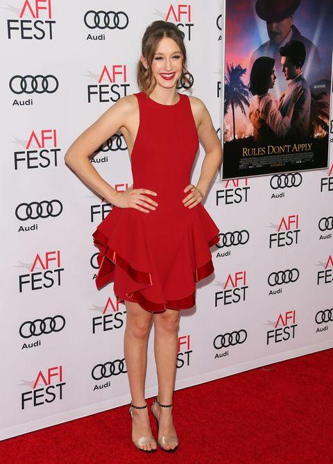Dress, Flooring, Shoulder, Red, Premiere, Facial expression, Style, Carpet, Cocktail dress, One-piece garment,