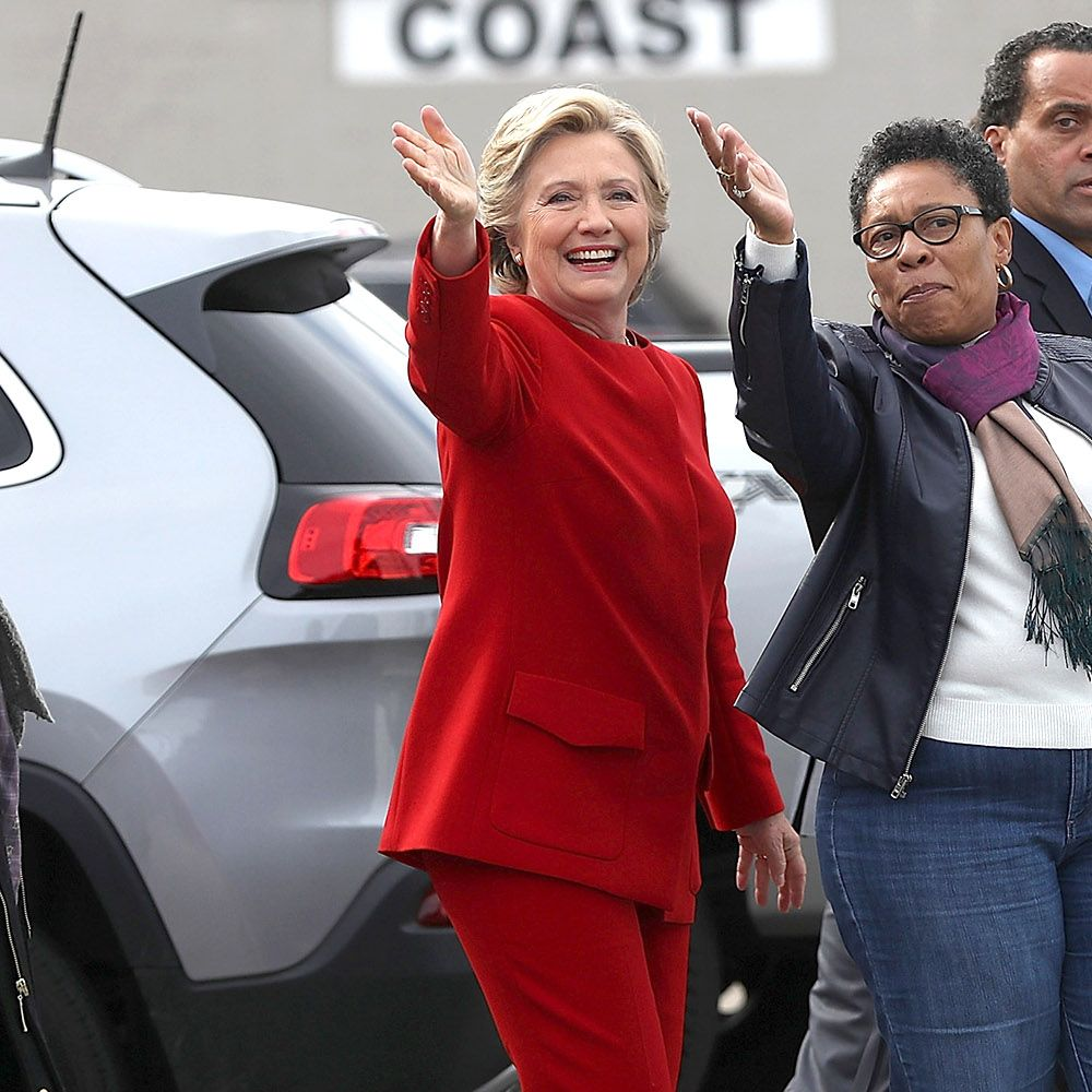 CLEVELAND, OH - OCTOBER 31:  Democratic presidential nominee former Secretary of State Hillary Clinton (C) jokes with U.S. Rep Marcia Fudge (D-OH) (R) as they wave to supporters outside of Angie's Soul Cafe on October 31, 2016 in Cleveland, Ohio. With just over a week to go until election day, Hillary Clinton is campaigning in the battleground state of Ohio.  (Photo by Justin Sullivan/Getty Images)