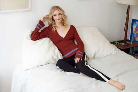 """<p><strong data-redactor-tag=""""strong"""" data-verified=""""redactor"""">Her Laid Back Look:</strong> """"On the weekends, nothing should feel too overdone. A slinky knit sweater against bare skin is the most comfortable thing. A large part of my down time consists of lounging around my apartment; or hanging out on a bench people-watching in Tompkins Square Park. I've lived in the East Village for the past 13 years and love the authenticity of the neighborhood."""" </p>  <p><em data-redactor-tag=""""em"""" data-verified=""""redactor"""">Nomia 'Deep V' Sweater, <a href=""""http://store.nomia-nyc.com/category/tops"""" target=""""_blank"""" data-tracking-id=""""recirc-text-link"""">store.nomia-nyc.com</a>; Topshop 'Side Stripe' Trousers, for similar styles visit <a href=""""http://shop.nordstrom.com/s/topshop-side-stripe-peg-trousers/4438026?origin=keywordsearch-personalizedsort&fashioncolor=BLACK"""" target=""""_blank"""" data-tracking-id=""""recirc-text-link"""">nordstrom.com</a>.</em></p>"""