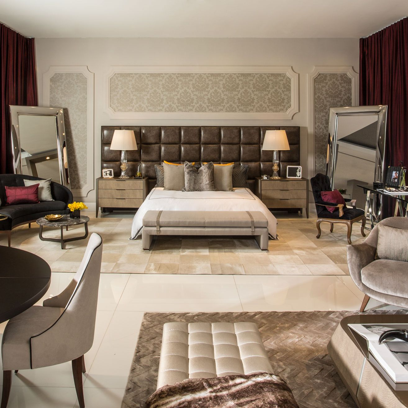 <p>Cary Fernandez paired with Dolce &amp&#x3B; Gabbana for her first appearance at the Design House, and created a bedroom concept revolving around deep maroons and beiges. Curvy arrangements and leather pieces help to exude D&amp&#x3B;G's authentic elegance. </p>