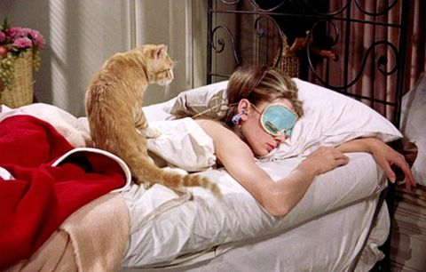"<p>Audrey Hepburn catches some zzz's as Holly Golightly in <em data-redactor-tag=""em"" data-verified=""redactor"">Breakfast at Tiffany's</em>. The world suddenly realizes that sleep accessories can be fiercely chic.</p>"