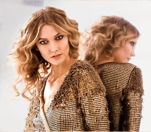 "<p>To get the look, use a 1½- inch-barrel curling iron—like <a href=""http://www.target.com/p/conair-instant-heat-curling-iron-3-4/-/A-10878189?ref=tgt_adv_XS000000&AFID=google_pla_df&CPNG=PLA_Health+Beauty+Shopping&adgroup=SC_Health+Beauty&LID=700000001170770pgs&network=g&device=c&location=9032022&gclid=CjwKEAiAmdXBBRD0hZCVkYHTl20SJACWsZj9dqGptJA0TNg_srFVEeYNmy4wFBmJGPiWSi4rkxV3IBoCkADw_wcB&gclsrc=aw.ds"" target=""_blank"" data-tracking-id=""recirc-text-link"">Conair Instant Heat Curling Iron</a> ($13)—and curl wide sections of your hair. Then break up spirals with a paddle brush, says celebrity hairstylist Nathaniel Hawkins. </p>"