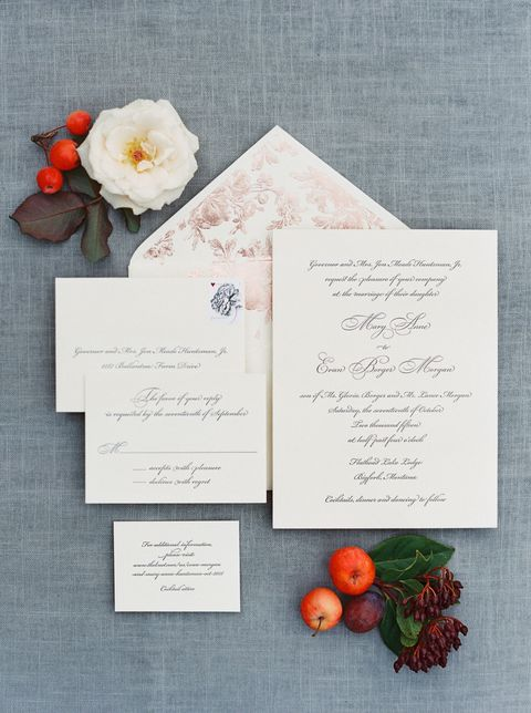 <p>The couple opted for a classic invitation suite, paired with a rose gold brocade envelope liner to hint to the warm, romantic vibes of their autumn celebration.</p>