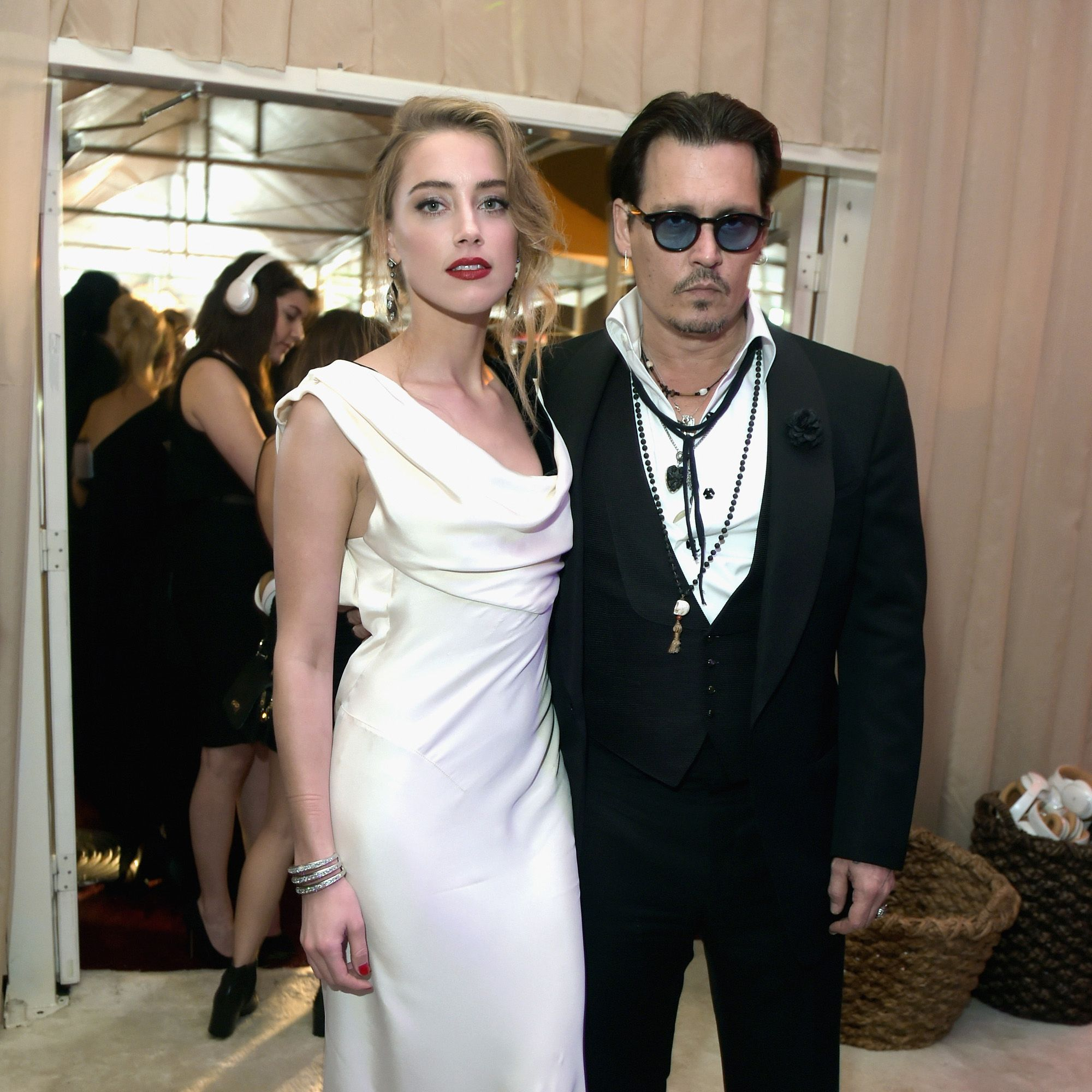 "<p>After just one year of marriage, <a href=""http://www.harpersbazaar.com/celebrity/latest/a15808/amber-heard-johnny-depp-divorce/"" target=""_blank"" data-tracking-id=""recirc-text-link"">Heard filed for divorce</a> from Depp back in May, citing ""irreconcilable differences."" One day later, the actress <a href=""http://www.harpersbazaar.com/celebrity/latest/news/a15837/amber-heard-files-domestic-restraining-order-against-johnny-depp/"" target=""_blank"" data-tracking-id=""recirc-text-link"">filed a domestic violence restraining order</a> against the actor, alleging that he was abusive in their relationship. Following a months-long (and not so friendly) battle, Heard dismissed her domestic violence restraining order and Depp <a href=""http://www.harpersbazaar.com/celebrity/latest/news/a17201/johnny-depp-amber-heard-divorce-settled/"" target=""_blank"" data-tracking-id=""recirc-text-link"">paid the actress $7 million</a> in a settlement—all of which she donated to charity. </p>"