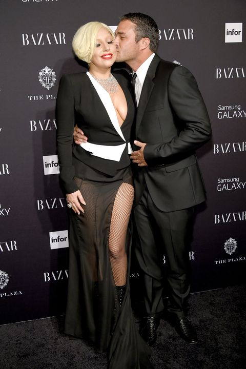 "<p>After more than five years together, the couple <a href=""http://www.harpersbazaar.com/celebrity/latest/news/a16737/lady-gaga-taylor-kinney-break-up/"" target=""_blank"" data-tracking-id=""recirc-text-link"">broke off their engagement</a> over the summer. Gaga announced the news on <a href=""https://www.instagram.com/p/BIEbofjjSUt/"" target=""_blank"" data-tracking-id=""recirc-text-link"">Instagram</a>, writing, ""Taylor and I have always believed we are soulmates. Just like all couples we have ups and downs, and we have been taking a break. We are both ambitious artists, hoping to work through long-distance and complicated schedules to continue the simple love we have always shared. Please root us on. We're just like everybody else and we really love each other."" Since then, however, the couple has not been spotted together and the singer admitted her new song ""Perfect Illusion"" was <a href=""http://www.harpersbazaar.com/culture/art-books-music/news/a18062/lady-gaga-taylor-kinney-perfect-illusion/"" target=""_blank"" data-tracking-id=""recirc-text-link"">inspired by Kinney</a>. </p>"