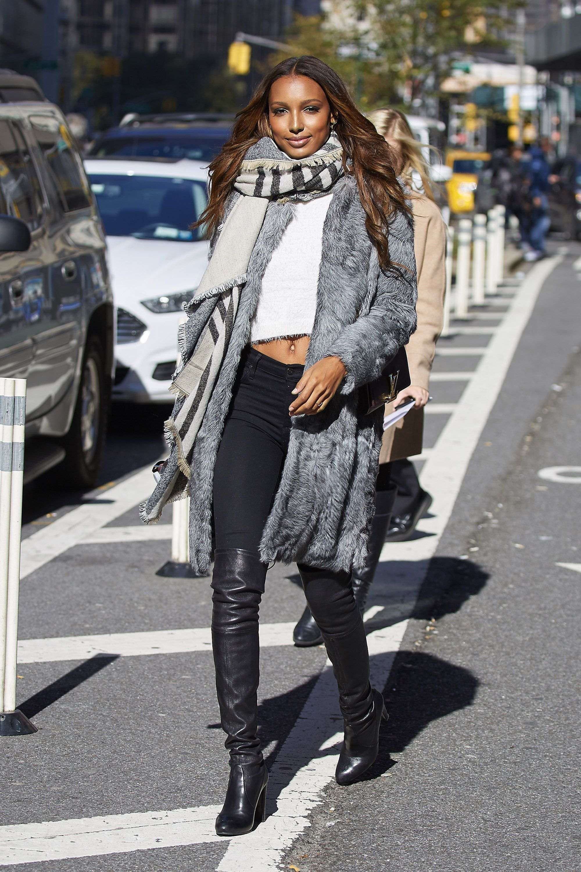 This fedora looks perfect worn with pale blue denim jacket, country style dress, black tights, knee-length suede boots, shoulder bag and heavy knit scarf: There is kind of grunge touch in this look. We see slim pullover worn atop white shirt embellished with studs which is tucked in ripped slim jeans.
