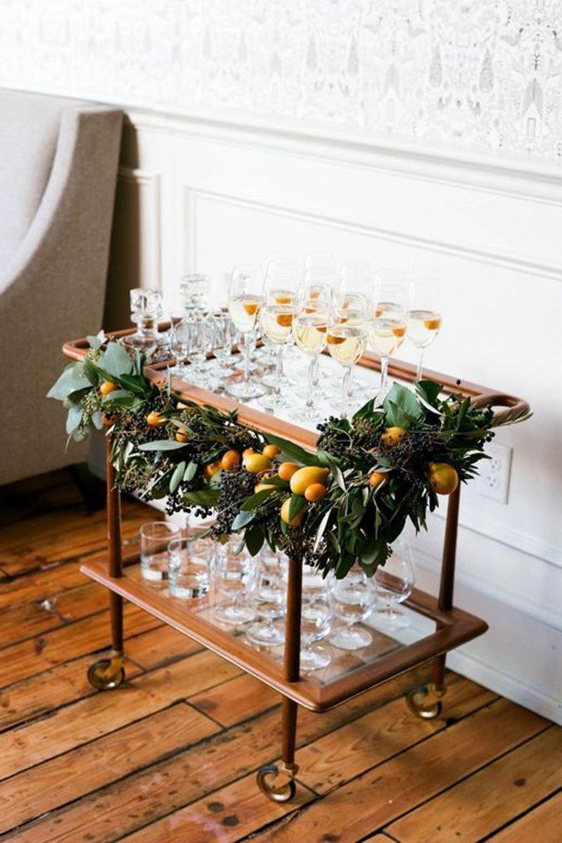 "<p>Your spirits will taste that much better getting shaken up atop a festive bar cart. </p> <p><em data-redactor-tag=""em""><a href=""http://www.munsterrose.com/blog/winter-in-season-feature-with-martha-stewart-weddings-part-1"" target=""_blank"" data-tracking-id=""recirc-text-link"">Via Munster Rose</a></em></p>"