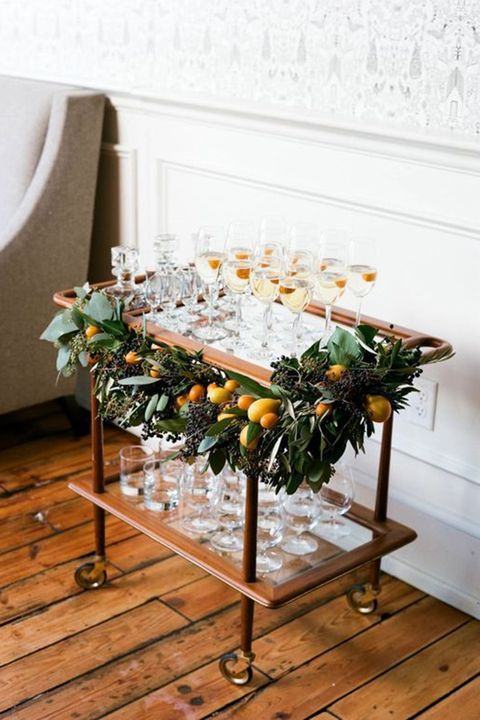 "<p>Your spirits will taste that much better getting shaken up atop a festive bar cart. </p>  <p><em data-redactor-tag=""em""><a href=""http://www.munsterrose.com/blog/winter-in-season-feature-with-martha-stewart-weddings-part-1"" target=""_blank"" data-tracking-id=""recirc-text-link"">Via Munster Rose</a></em></p>"