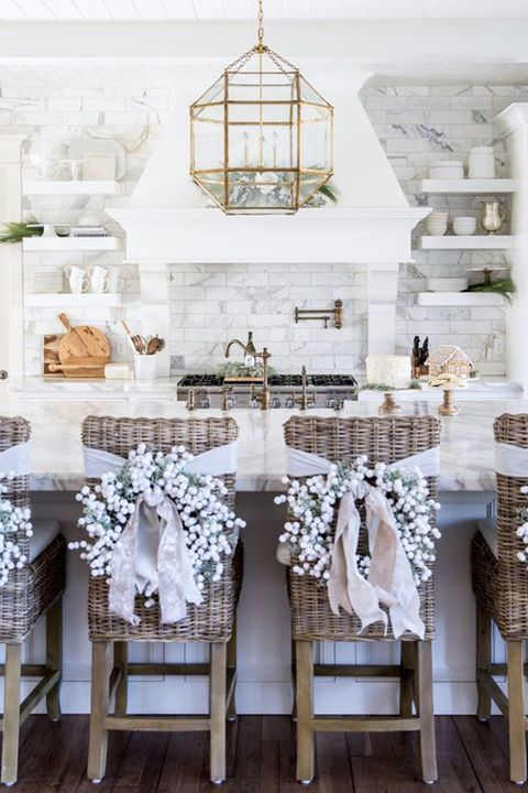 "<p>Give your kitchen or dining room chairs a dose of holiday cheer with individual wreaths in winter white. </p>  <p><em data-redactor-tag=""em""><a href=""http://pinkpeonies.com/our-home-for-christmas/"" target=""_blank"" data-tracking-id=""recirc-text-link"">Via Pink Peonies</a></em></p>"