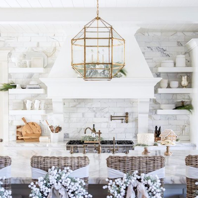 <p>Give your kitchen or dining room chairs a dose of holiday cheer with individual wreaths in winter white. </p>