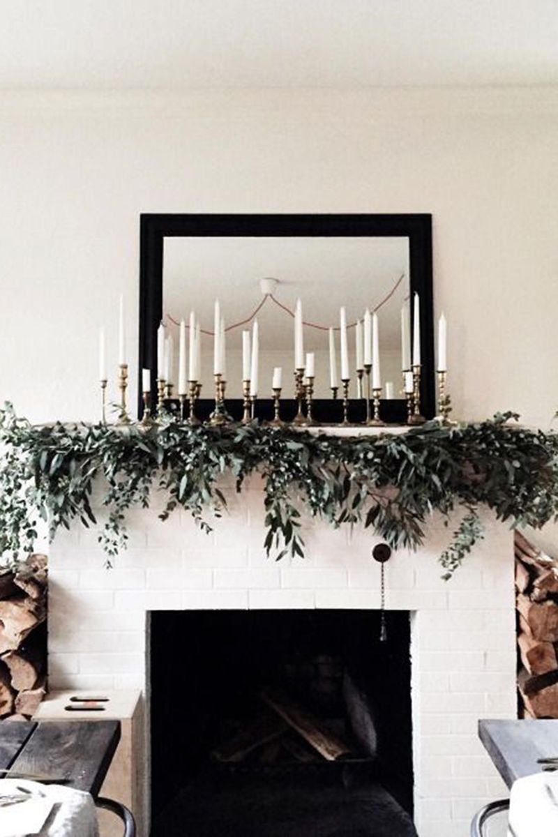 """<p>Make your mantlescape the main event with a cluster of candles and simple greenery that feels effortlessly elegant. </p> <p><em data-redactor-tag=""""em""""><a href=""""https://www.instagram.com/p/-FNoNSOOnx/"""" target=""""_blank"""" data-tracking-id=""""recirc-text-link"""">Via Tribes N Pines</a></em></p>"""