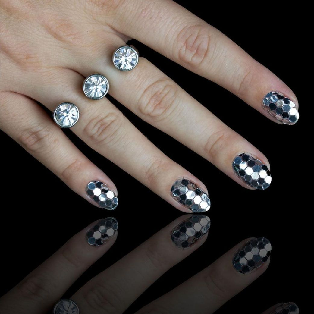 """<p>Disco nails inspired by New York City's ball drop.</p><p><del data-redactor-tag=""""del""""></del></p><p><a href=""""https://www.instagram.com/p/9Peor7t77p/"""" target=""""_blank"""" data-tracking-id=""""recirc-text-link"""">@chelseaqueen</a> </p>"""