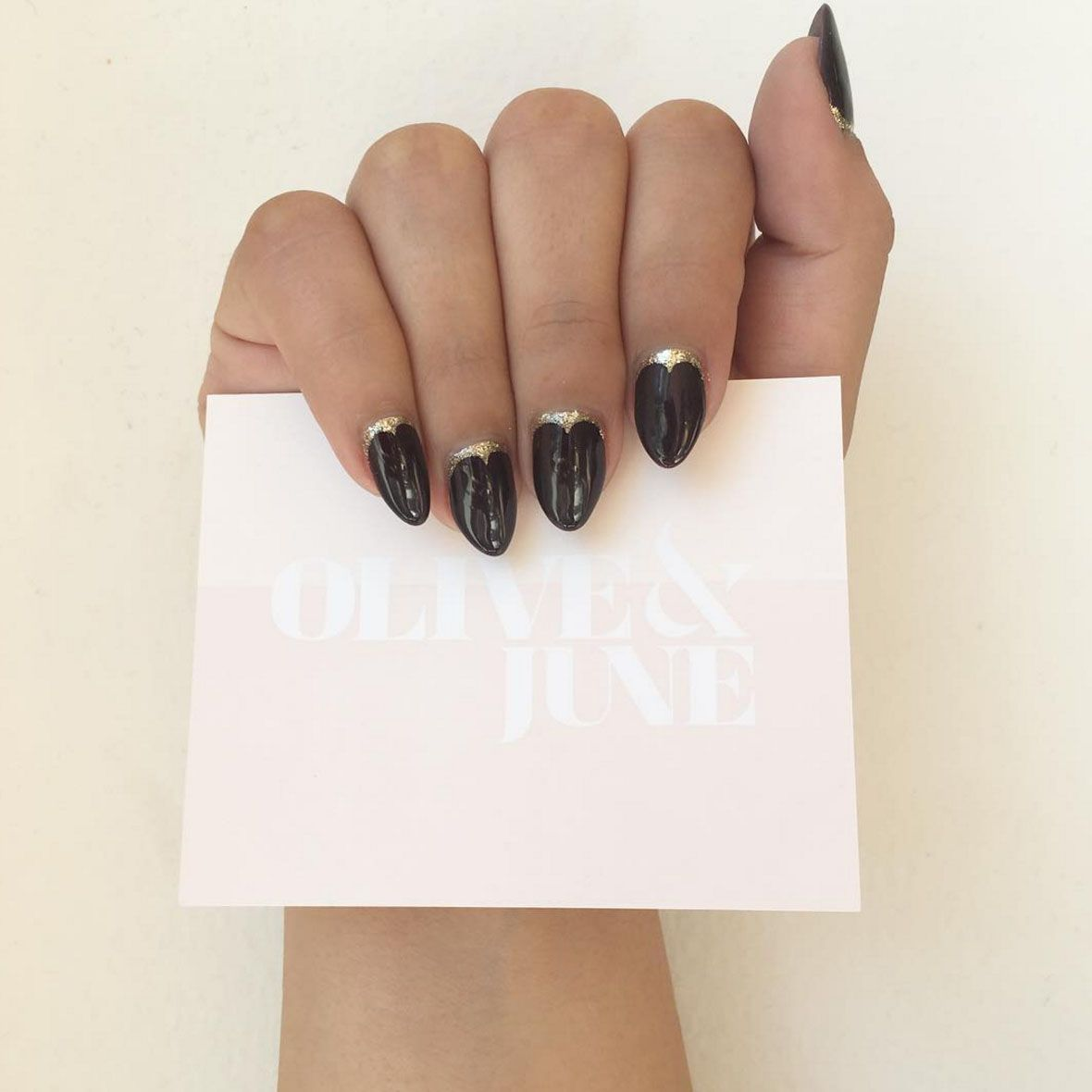 """<p>The manicure version of your holiday LBD: this reverse French adorned with scalloped glitter.</p><p><a href=""""https://www.instagram.com/p/BLHnZnthJOt/?taken-by=oliveandjune&amp&#x3B;hl=en"""" target=""""_blank"""" data-tracking-id=""""recirc-text-link"""">@oliveandjune</a></p>"""