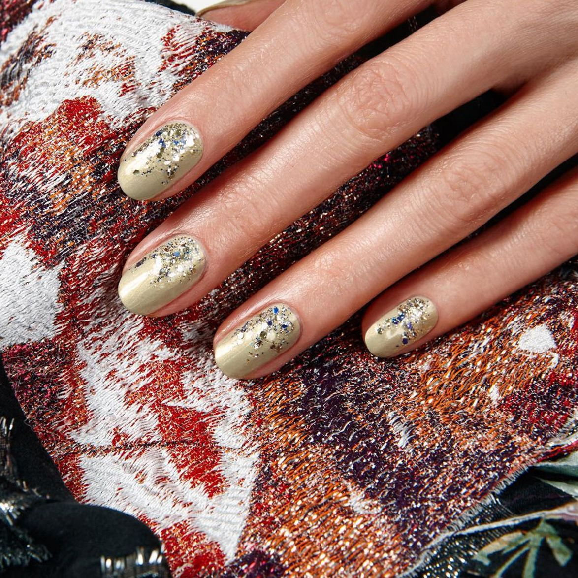 """<p>Take a gold nail look one step further by diffusing a thick glittery top coat starting at cuticle.</p><p><a href=""""https://www.instagram.com/p/BAOLB6fxL1N/?taken-by=jinsoonchoi"""" target=""""_blank"""" data-tracking-id=""""recirc-text-link"""">@jinsoonchoi</a></p>"""