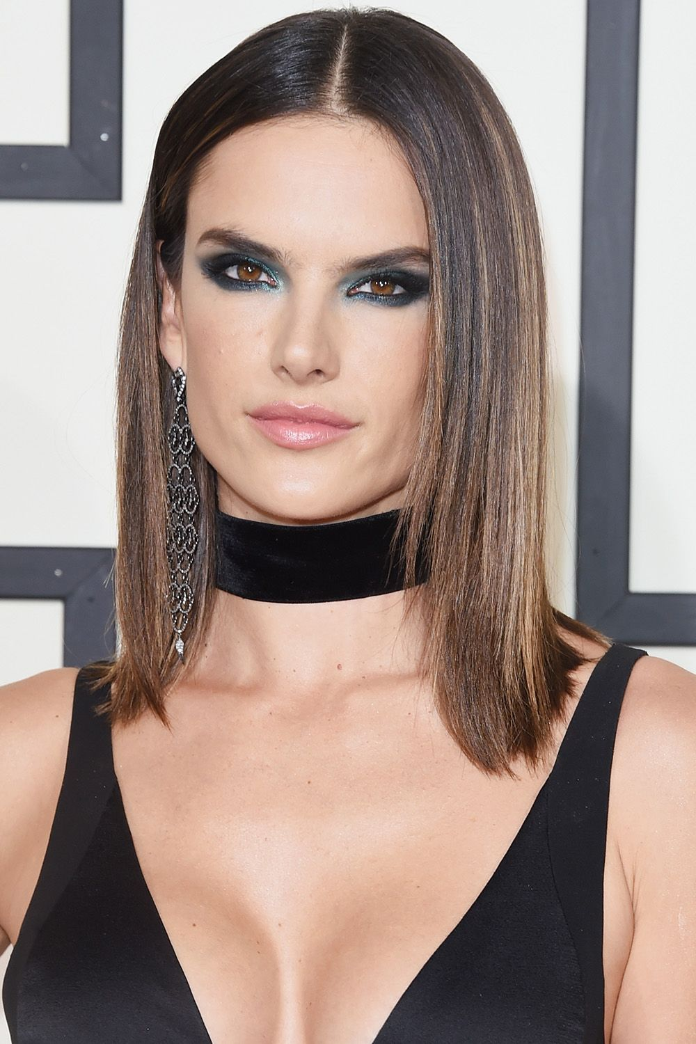 <p>Alessandra Ambrosio's sleek lob and smoky blue-green eyes are a much edgier look than the one she's known for on the VS runway.</p>