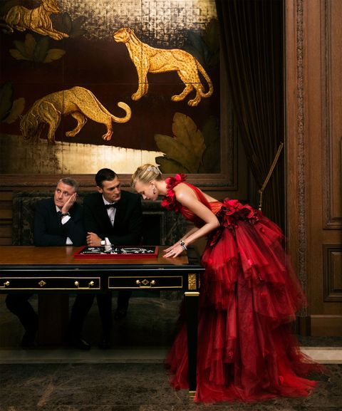 "<p>Leaning in at the mansion's Panther Hall. </p>  <p><em data-redactor-tag=""em"" data-verified=""redactor""><strong data-redactor-tag=""strong"" data-verified=""redactor"">Marchesa</strong><strong data-redactor-tag=""strong"" data-verified=""redactor""> </strong>gown, $14,995, <a href=""http://www.neimanmarcus.com/"" target=""_blank"" data-tracking-id=""recirc-text-link"">neimanmarcus.com</a>; <strong data-redactor-tag=""strong"" data-verified=""redactor"">Cartier</strong> headpiece, earrings, bracelet, and ring, prices upon request, 800-CARTIER. </em><em data-redactor-tag=""em"" data-verified=""redactor""></em></p>"