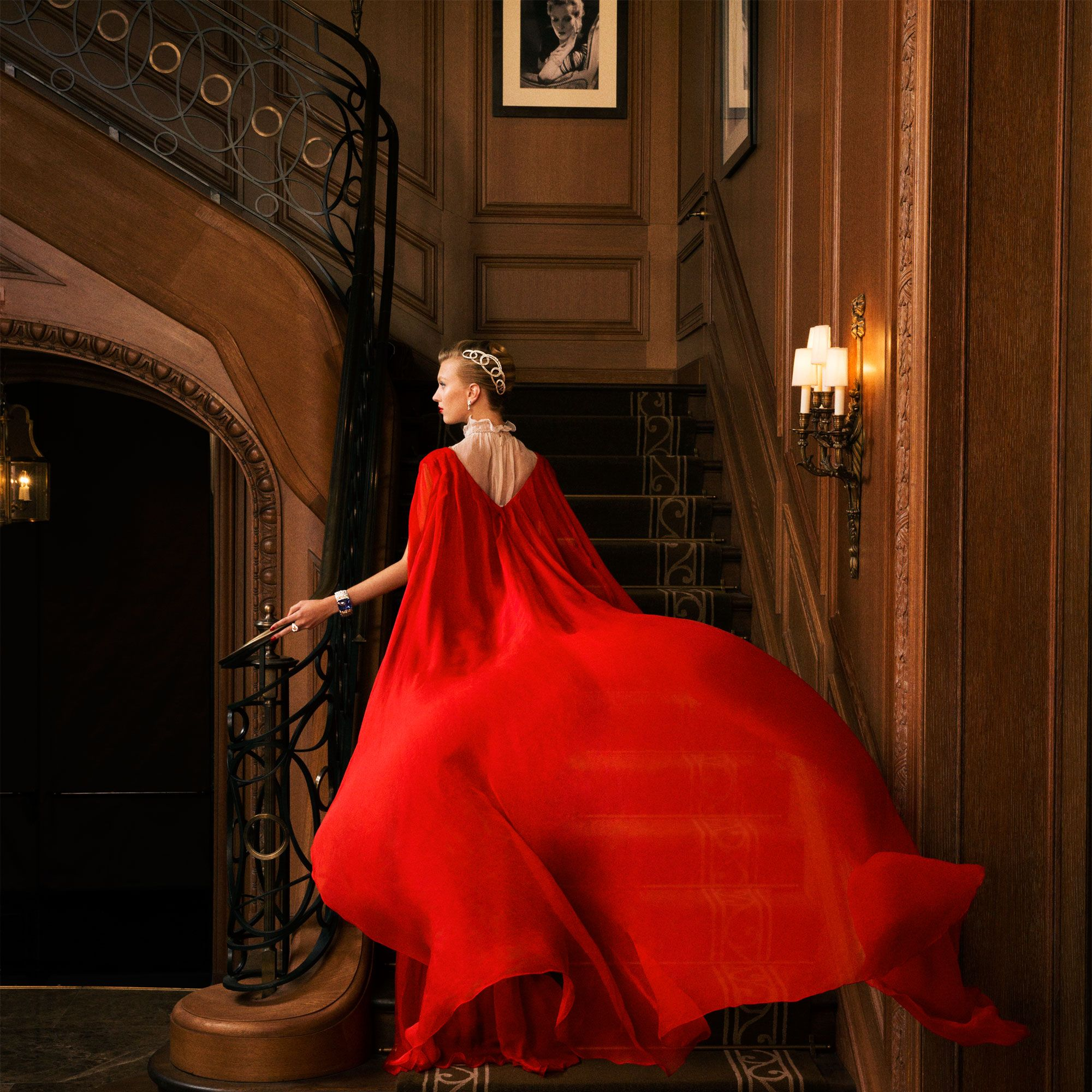 """<p>The grand staircase in the Cartier flagship, whose renovation was overseen by architect Thierry Despont. Pierre Cartier traded a natural-pearl necklace—then valued at $1 million—for the neo-Renaissance building in 1917. </p><p><em data-redactor-tag=""""em"""" data-verified=""""redactor""""><strong data-redactor-tag=""""strong"""" data-verified=""""redactor"""">Valentino</strong> Haute Couture dress and bodysuit, prices upon request, <a href=""""http://www.valentino.com/us"""" target=""""_blank"""" data-tracking-id=""""recirc-text-link"""">valentino.com</a>&#x3B; <strong data-redactor-tag=""""strong"""" data-verified=""""redactor"""">Cartier</strong> tiara, earrings, bracelet, and ring, prices upon request, 800-CARTIER. </em></p>"""