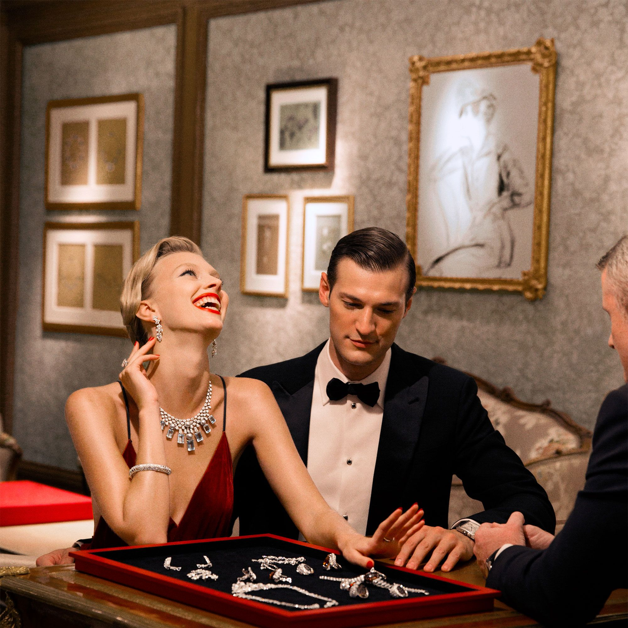 """<p>Dripping in diamonds in the VIP salon. </p><p><em data-redactor-tag=""""em"""" data-verified=""""redactor""""><strong data-redactor-tag=""""strong"""" data-verified=""""redactor"""">Ralph Lauren Collection </strong>dress, $4,790, <a href=""""http://www.ralphlauren.com/home/index.jsp?direct"""" target=""""_blank"""" data-tracking-id=""""recirc-text-link"""">ralphlauren.com</a>&#x3B; <strong data-redactor-tag=""""strong"""" data-verified=""""redactor"""">Cartier </strong>jewelry (on tray), prices upon request, 800-CARTIER&#x3B; <strong data-redactor-tag=""""strong"""" data-verified=""""redactor"""">Giorgio Armani</strong> tuxedo, $3,695, shirt, $825, and bow tie, $225, <a href=""""http://www.armani.com/us/giorgioarmani"""" target=""""_blank"""" data-tracking-id=""""recirc-text-link"""">armani.com</a>&#x3B; <strong data-redactor-tag=""""strong"""" data-verified=""""redactor"""">Cartier</strong> cuff links, $15,600, stud sets, prices upon request, and watch, $9,950, 800-CARTIER&#x3B; <strong data-redactor-tag=""""strong"""" data-verified=""""redactor"""">Church's</strong> shoes, $615, <a href=""""http://www.church-footwear.com/uk/en"""" target=""""_blank"""" data-tracking-id=""""recirc-text-link"""">church-footwear.com</a>. </em></p>"""