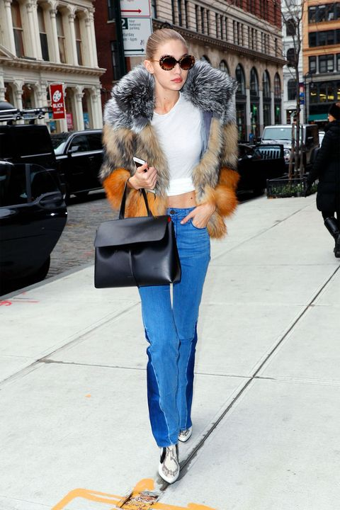 835dcf0d59614 Not even falling temperatures could keep Gigi Hadid from showing a hint of  skin in her cool flared jeans and cropped tee.