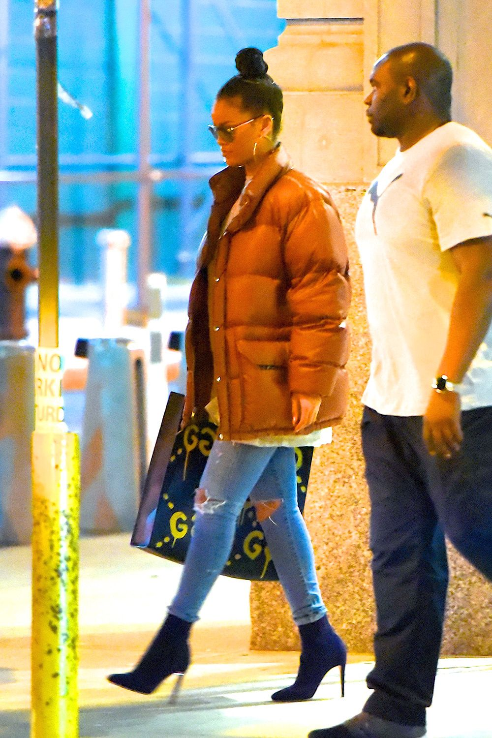 <p>Start off with the classic pairing: puffer jacket, jeans and ankle boots. Top it off with a statement bag like the GucciGhost tote. (Mind you, Rihanna wore this in August.) </p>