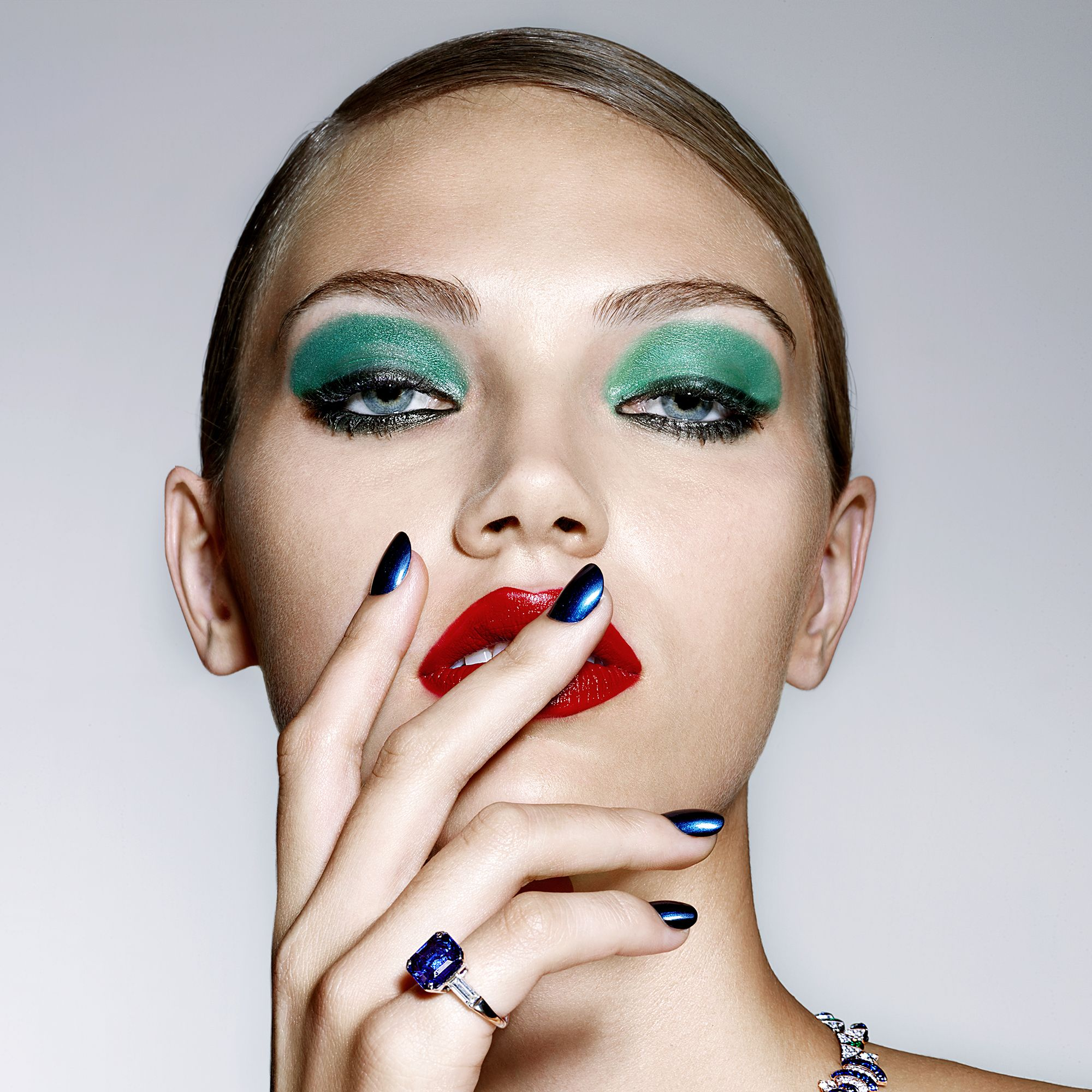 """<p><strong data-redactor-tag=""""strong"""" data-verified=""""redactor"""">BEAUTY BAZAAR: </strong>For sapphire-blue tips, wear <a href=""""http://www.lancome-usa.com/makeup/lips-and-nails/nail-polish/vernis-in-love/1000429.html"""" target=""""_blank"""" data-tracking-id=""""recirc-text-link"""">Lancôme Vernis in Love in Rive Gauche</a> ($16).</p><p><strong data-redactor-tag=""""strong"""" data-verified=""""redactor"""">Bulgari </strong>necklace, bracelet, and ring, prices upon request, <a href=""""http://www.bulgari.com/en-us/"""" target=""""_blank"""" data-tracking-id=""""recirc-text-link"""">bulgari.com</a>.</p><p></p>"""