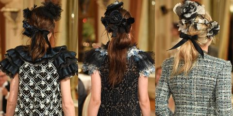 <p>The hair at Chanel's Pre-fall 2017 show was adorned with floral pins, tied back into a ponytail, and secured with a shiny black bow. </p>