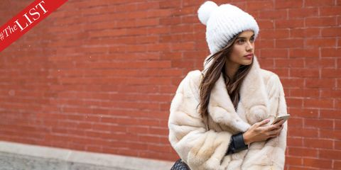 Textile, Red, Brick, Winter, Fur clothing, Street fashion, Fashion accessory, Wool, Headgear, Natural material,