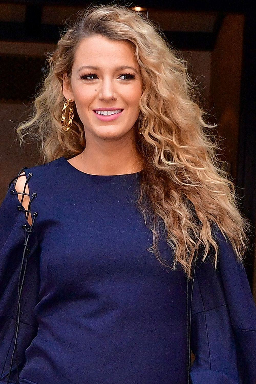 <p>Just when we thought Blake Lively's hair couldn't reach any more levels of perfection, she stepped-put with these springy curls this past summer. </p>