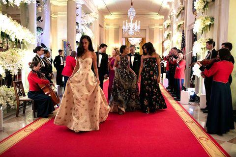 Lighting, Event, Flooring, Dress, Carpet, Red, Floor, Formal wear, Interior design, Coat,