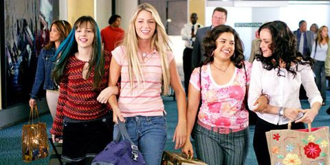 Smile, Jeans, Social group, Bag, Happy, Denim, Community, Facial expression, Luggage and bags, Friendship,