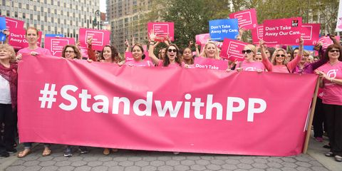Human, People, Social group, Red, Text, Pink, Protest, Magenta, Public event, Advertising,