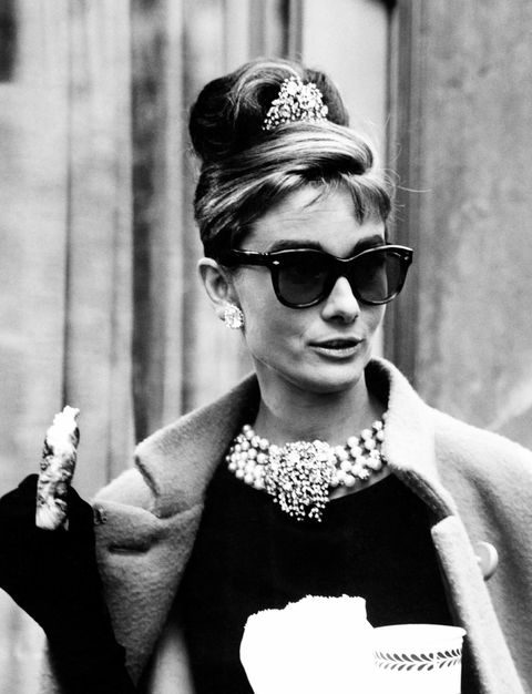 "<p>The baby bags, chunky blonde highlights, and twisted updo that Holly Golightly wears in <em data-redactor-tag=""em"" data-verified=""redactor"">Breakfast at Tiffany's</em> is often imitated, never duplicated.&nbsp&#x3B;</p>"