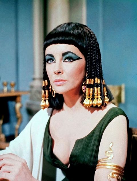 "<p>The hair might be second fiddle to the makeup in <em data-redactor-tag=""em"" data-verified=""redactor"">Cleopatra</em>, but it's truly just as incredible. Gilded with beads or covered in elaborate headpieces, Elizabeth Taylor wore the dramatic styles with regal ease.</p>"