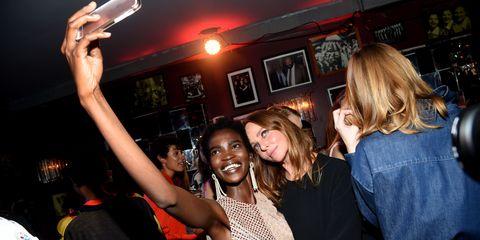 Arm, Hand, Party, Mobile phone, Pub, Bar, Music venue, Nightclub, Telephony, Gadget,
