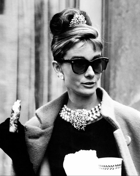 The baby bags, chunky blonde highlights, and twisted updo that Holly Golightly wears in Breakfast at Tiffany's is often imitated, never duplicated.