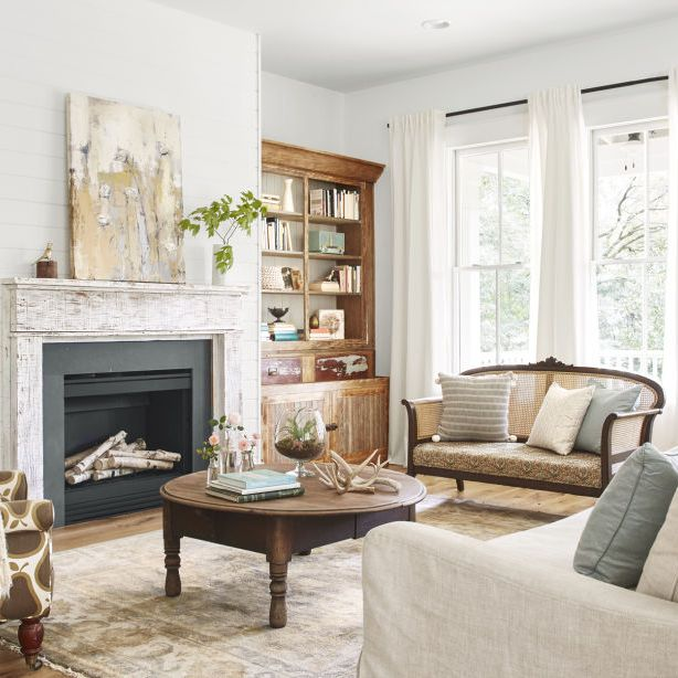 "<p>A mix of vintage and catalog finds lends a casual vibe in <a href=""http://www.countryliving.com/home-design/house-tours/g3208/southern-georgia-farmhouse/"" target=""_blank"" data-tracking-id=""recirc-text-link"">this Georgia farmhouse's</a>&nbsp&#x3B;living room, where pine bookcases, rescued from a demolished elementary school, keep company with a new linen sofa. An abstract painting by artist —and&nbsp&#x3B;<em data-redactor-tag=""em"">CL&nbsp&#x3B;</em>General Store vendor—<a href=""http://www.deanndesigns.com/"" target=""_blank"">Deann Hebert</a>&nbsp&#x3B;adds texture above the chippy mantel.<span class=""redactor-invisible-space"" data-verified=""redactor"" data-redactor-tag=""span"" data-redactor-class=""redactor-invisible-space""></span></p>"