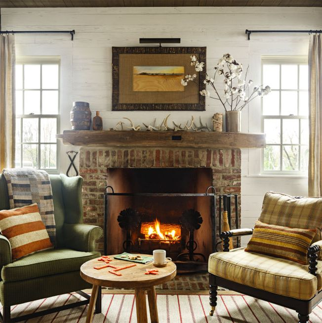 "<p>A wingback chair and a spindle chair give <a href=""http://www.countryliving.com/home-design/house-tours/g3687/beechwood-farm-debra-koehler/?slide=1"" target=""_blank"" data-tracking-id=""recirc-text-link"">this Alabama dogtrot home</a>'s living ri a collected-over-time vibe. The rustic mantel makes things feel extra rustic.</p>"