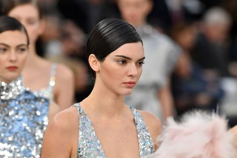 <p>At Chanel couture, the models walked the runway in show-stopping embellished silver gowns. There was enough glitz to distract you from perhaps the biggest news of the day: the models all walked with a smattering of silver glitter highlighter along their upper cheekbones. It's safe to say the glitter and highlighter trends aren't going anywhere.</p>